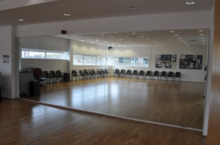 Mirror glass for dance Schools and gyms full size safety glass mirrors for gyms and studios supplied and installed northern ireland Glazier
